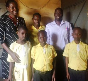 annette-with-headmaster-jonathan-and-bsuf-students
