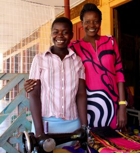 Annette with Proscovia (prose) Kasega_Tailor from the BSUF family who has to look after her mother who has HIV and is blind.
